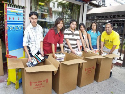 Volunteers to fill a library with volumes